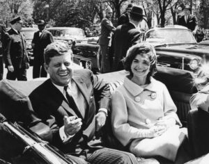United States President John F. Kennedy and first lady Jackie Kennedy sit in a car in front of Blair House during the arrival ceremonies for Habib Bourguiba, president of Tunisia, in Washington, in this handout image taken on May 3, 1961